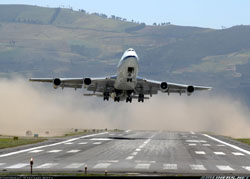 Photo of a B-747 lifting off