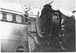 Photo of damage to No. 1 engine and left fuselage