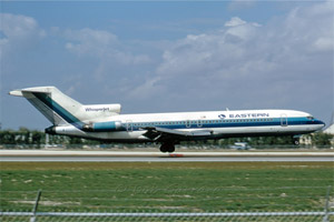 Photo of Eastern 727-225, N8845E landing at Miami in February 1974