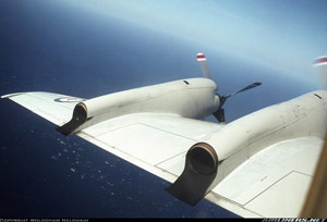 Loockheed P-3 military viarant of the Electra in flight with Number 1 propeller feathered