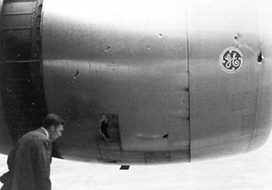 Photo of No. 1 engine cowl showing impact damage