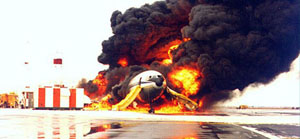 Photo of the accident airplane on fire