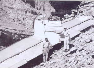 Photo of park rangers standing next to L-1049 tail