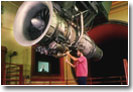 Photo: Engineer working on an airplane engine